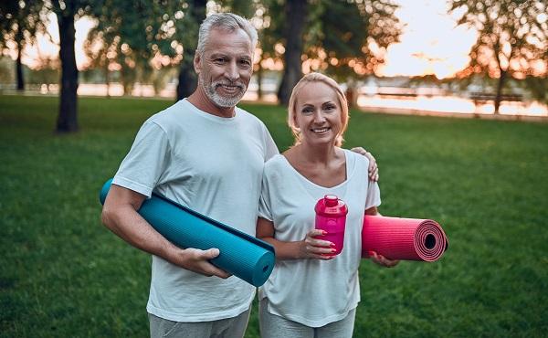 middle aged couple yoga